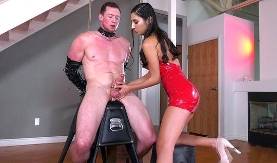 Chick in latex dress tied up man and handjob brought to orgasm