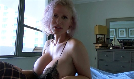 A mature aunt lifts up her dress, showing a shaved vagina and large milkings to a man