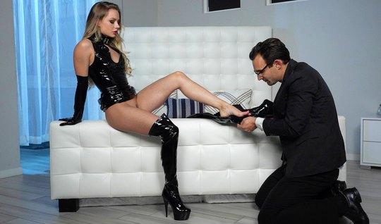 Girl in latex dominates man in black suit