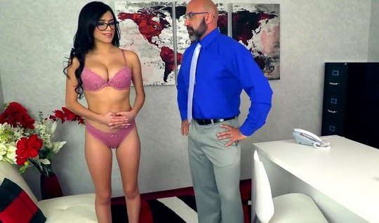 A bearded guy with glasses in the office crumpled his big boobs of a premium model and fucked